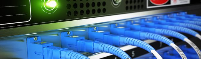 Multiple fiber optic cables plugged into an enterprise router