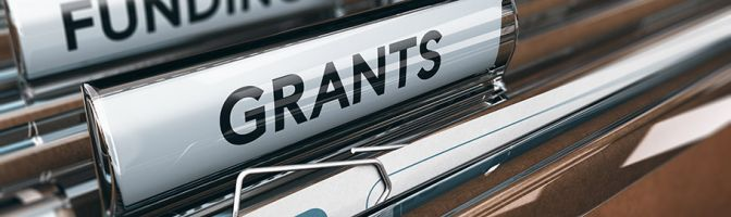 close up of a file folder with a grants label
