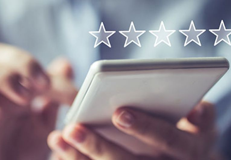 close up of person using phone with a star rating superimposed