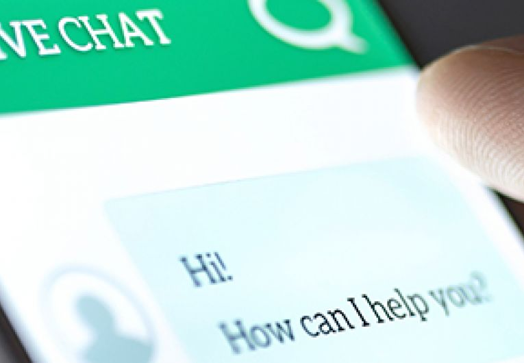 Closeup of mobile phone screen showing a live chat session.