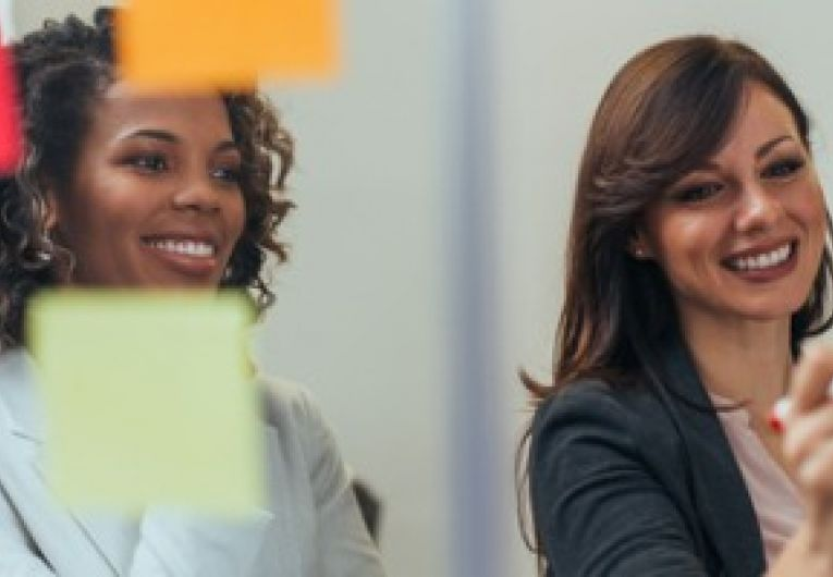 Two female business owners brainstorm ideas